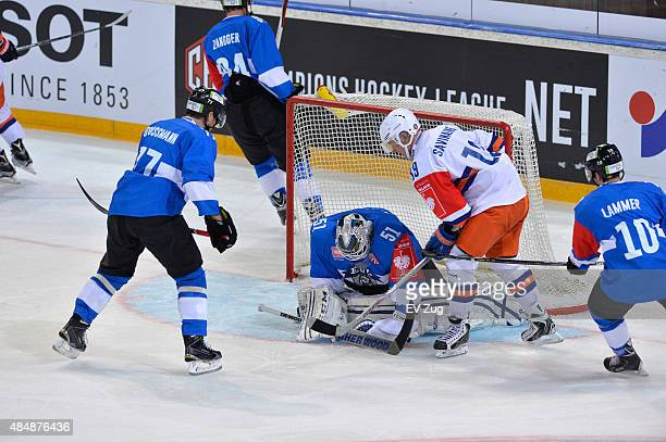 Robin Grossmann, Tobias Stephan and Dominic Lammer of Tappara Tampere fight for the puck against Veli-Matti Savinainen of EV Zug during the Champions...