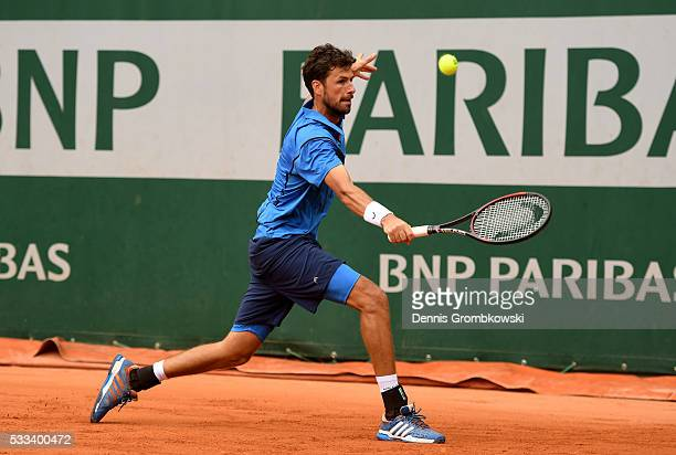 Robin Haase of Netherlands hits a backhand during the Mens Singles first round match against Jack Sock of the United States on day one of the 2016...