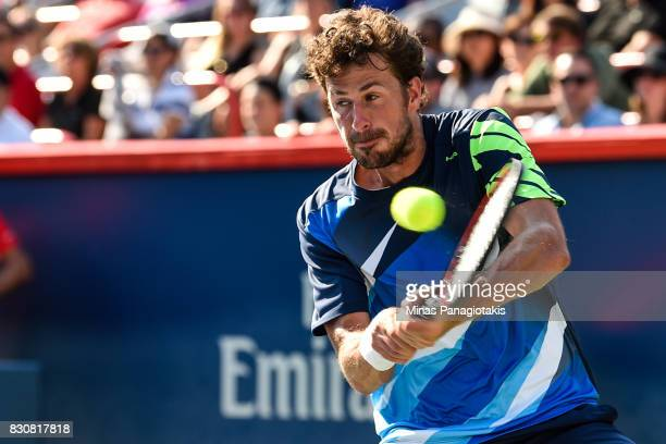 Robin Haase of Netherlands hits a return against Roger Federer of Switzerland during day nine of the Rogers Cup presented by National Bank at Uniprix...