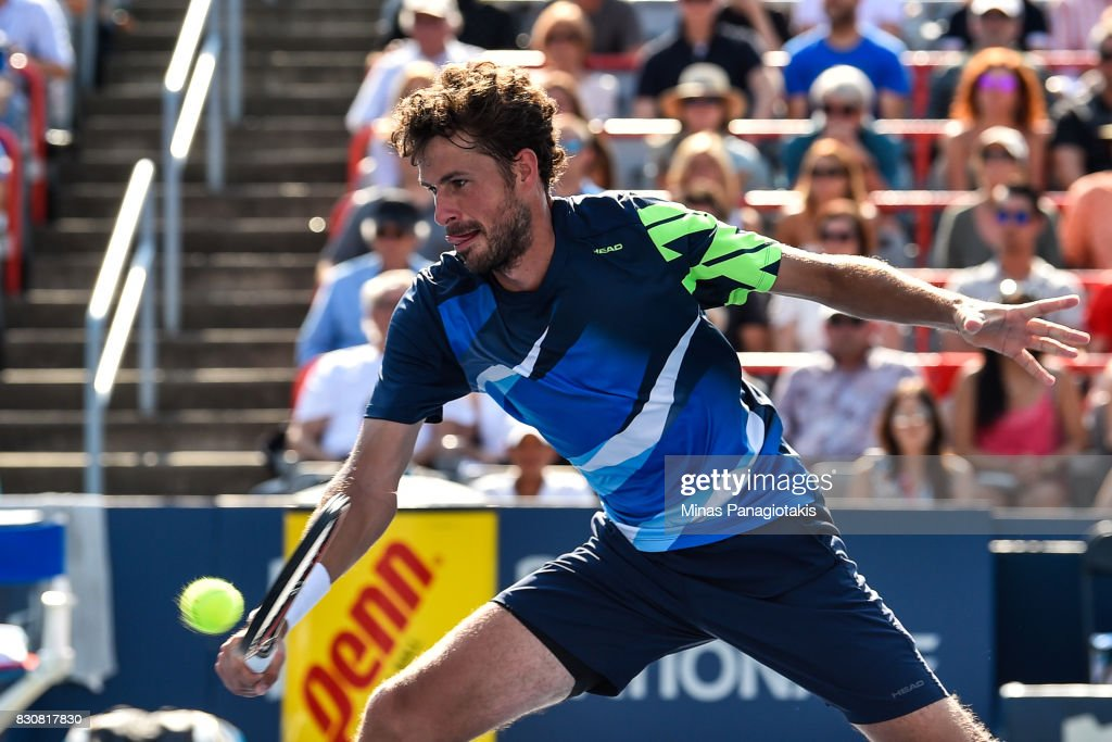 Robin Haase of Netherlands hits a return against Roger Federer of Switzerland during day nine of the Rogers Cup presented by National Bank at Uniprix Stadium on August 12, 2017 in Montreal, Quebec, Canada.