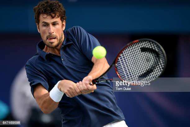 Robin Haase of Netherlands plays a backhand during his semi final match against Fernando Verdasco of Spain on day six of the ATP Dubai Duty Free...