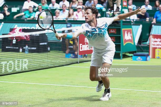 Robin Haase of Netherlands plays a backhand to Roberto Bautista Agut of Spain during their round of 16 match on day 3 of the Gerry Weber Open at...