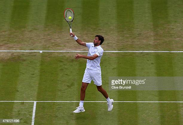 Robin Haase of Netherlands plays a volley during his Gentlemen's Singles second round match against Andy Murray of Great Britain during day four of...