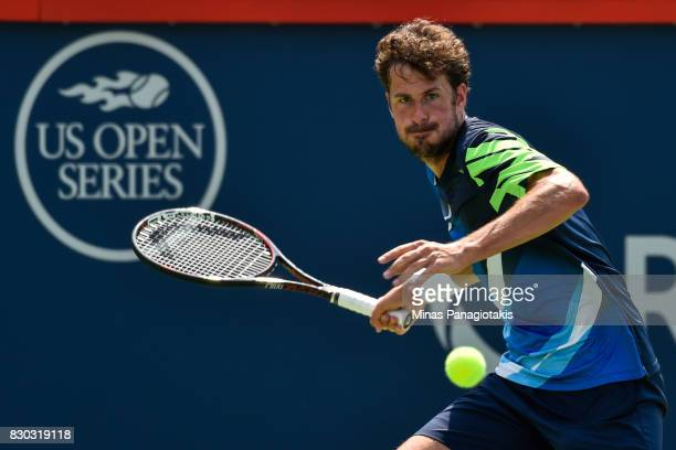 Robin Haase of Netherlands prepares to hit a return against Diego Schwartzman of Argentina during day eight of the Rogers Cup presented by National...