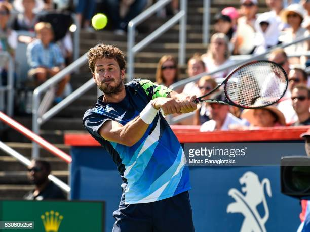 Robin Haase of Netherlands prepares to hit a return against Roger Federer of Switzerland during day nine of the Rogers Cup presented by National Bank...
