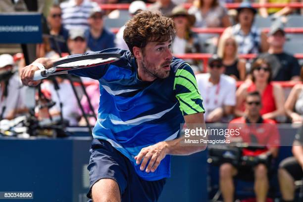 Robin Haase of Netherlands runs after the ball against Diego Schwartzman of Argentina during day eight of the Rogers Cup presented by National Bank...