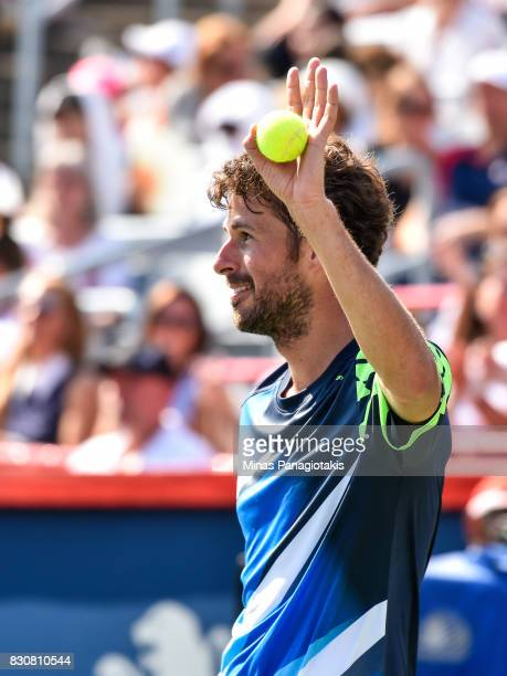 Robin Haase of Netherlands salutes the fans against Roger Federer of Switzerland during day nine of the Rogers Cup presented by National Bank at...