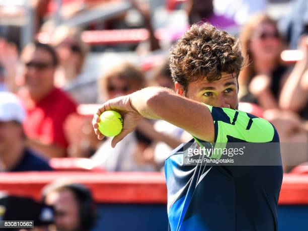 Robin Haase of Netherlands wipes himself down against Roger Federer of Switzerland during day nine of the Rogers Cup presented by National Bank at...