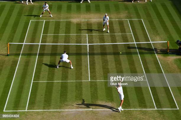 Robin Haase of the Netherlands and Robert Lindstedt of Sweden compete against Dominic Inglot of Great Britain and Franko Skugor of Croatia during...