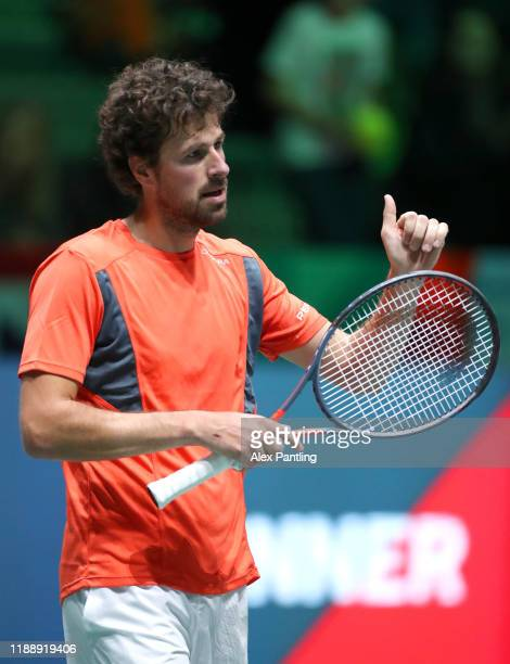 Robin Haase of the Netherlands applauds the fans after his Davis Cup Group Stage match against Daniel Evans of Great Britain during Day Three of the...