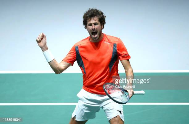 Robin Haase of the Netherlands celebrates match point and victory during his Davis Cup Group Stage match against Daniel Evans of Great Britain during...