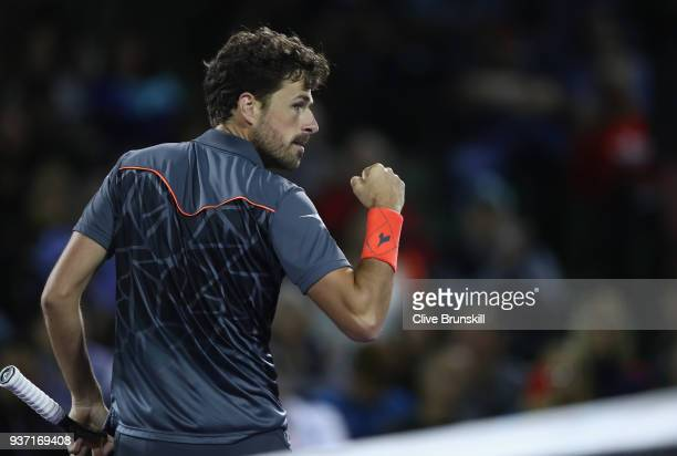 Robin Haase of the Netherlands celebrates winning the second set against Juan Martin Del Potro of Argentina in their second round match during the...