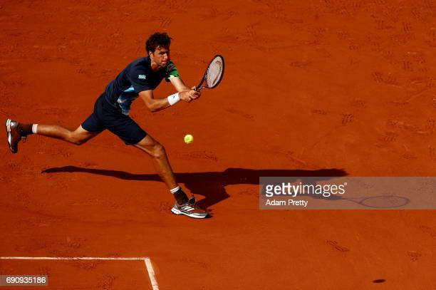 Robin Haase of The Netherlands hits a backhand during the second roun match against Rafael Nadal of Spain on day four of the 2017 French Open at...