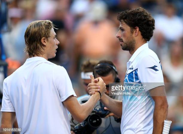 Robin Haase of The Netherlands is congratulated by Denis Shapovalov of Canada following a 3rd round match on Day 4 of the Rogers Cup at Aviva Centre...