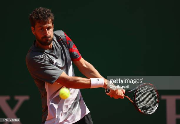 Robin Haase of the Netherlands plays a backhand against Dominic Thiem of Austria in his second round match on day four of the Monte Carlo Rolex...