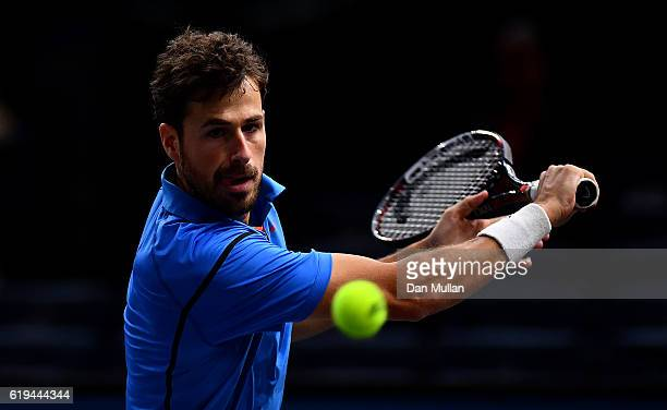 Robin Haase of the Netherlands plays a backhand during his Mens Singles match against Fernando Verdasco of Spain on day one of the BNP Paribas...