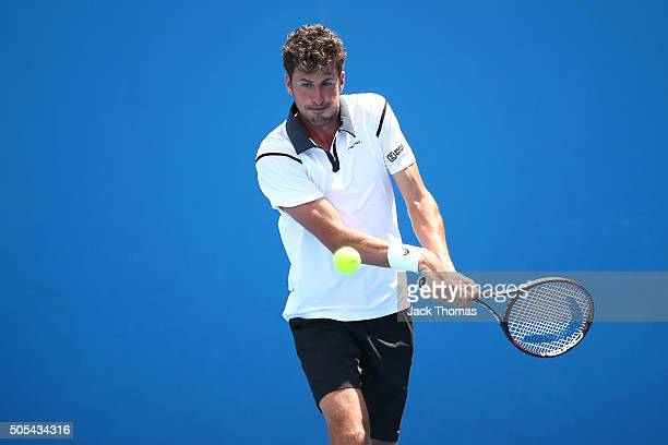 Robin Haase of the Netherlands plays a backhand in his first round match against Mirza Basic of Bosnia and Herzegovina during day one of the 2016...