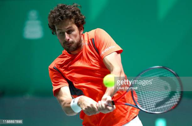 Robin Haase of the Netherlands plays a backhand shot during his Davis Cup Group Stage match against Daniel Evans of Great Britain during Day Three of...