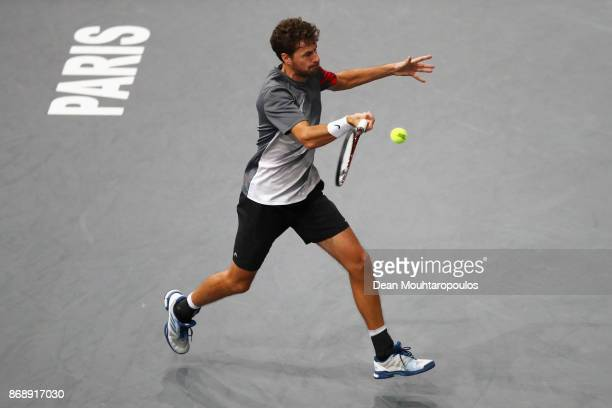 Robin Haase of the Netherlands plays a forehand against Alexander Zverev of Germany during Day 3 of the Rolex Paris Masters held at the AccorHotels...