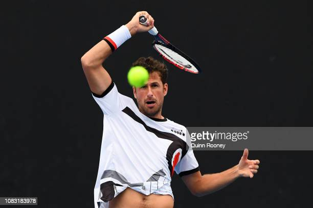 Robin Haase of the Netherlands plays a forehand in his first round doubles match with Matwe Middelkoop of the Netherlands against Ryan Harrison and...