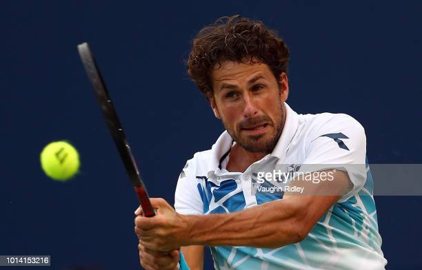 Robin Haase of The Netherlands plays a shot against Denis Shapovalov of Canada during a 3rd round match on Day 4 of the Rogers Cup at Aviva Centre on...