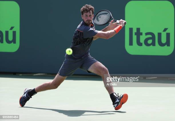 Robin Haase of the Netherlands plays a shot against Yuichi Sugita of Japan during Day 3 of the Miami Open at the Crandon Park Tennis Center on March...