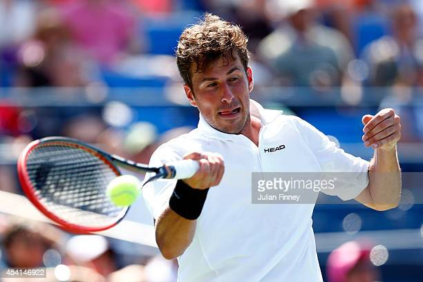 Robin Haase of the Netherlands retruns a shot against Andy Murray of Great Britain during his men's singles first round match on Day One of the 2014...