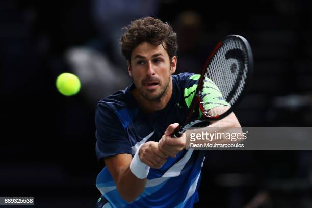 Robin Haase of the Netherlands returns a backhand in his match against Juan Martin del Potro of Argentina during Day 4 of the Rolex Paris Masters...