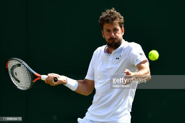 Robin Haase of the Netherlands returns a serve in his Men's Singles second round match against Milos Raonic of Canada during Day three of The...