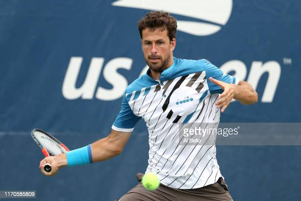 Robin Haase of the Netherlands returns a shot against Diego Schwartzman of Argentina during their Men's Singles first round match on day two of the...