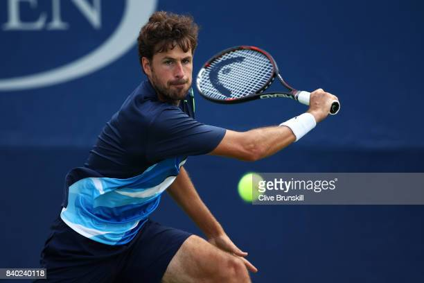 Robin Haase of the Netherlands returns a shot during his first round Men's Singles match against Kyle Edmund of Great Britain on Day One of the 2017...