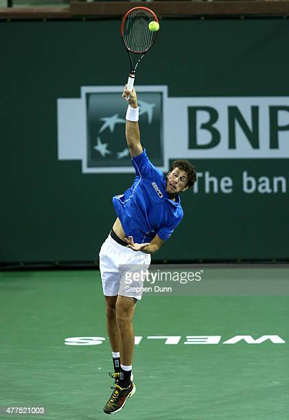 Robin Haase of the Netherlands serves to Grigor Dimitrov of Bulgaria during the BNP Paribas Open at Indian Wells Tennis Garden on March 9 2014 in...