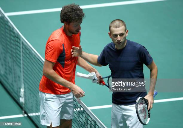 Robin Haase of the Netherlands shakes hands with Daniel Evans of Great Britain after their Davis Cup Group Stage match during Day Three of the 2019...