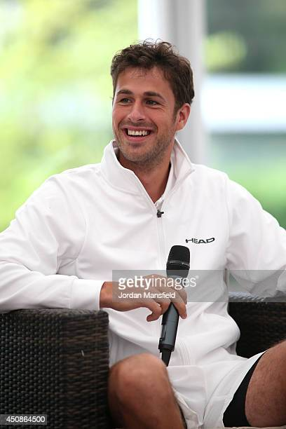 Robin Haase of the Netherlands talks to Di Dougherty prior to his match against John Isner of the USA during day three of The Boodles Tennis Event at...