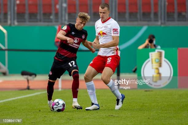 Robin Hack of 1FC Nuernberg and Lukas Klostermann of RB Leipzig during the DFB Cup first round match between 1 FC Nuernberg and RB Leipzig at...