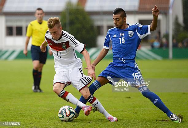 Robin Hack of Germany and Ben Hamo Mor Mordechay of Israel compete for the ball during the KOMM MIT tournament match between U17 Germany and U17...