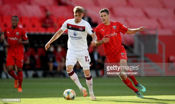 Robin Hack of Nuremberg is challenged by Maximilian Thalhammer of Ingolstadt during the 2. Bundesliga playoff second leg match between FC Ingolstadt...