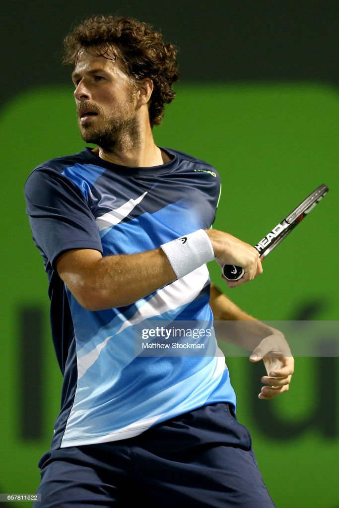 Robin Hasse of Netherlands returns a shot to Juan Martin Del Potro of Argentina during the Miami Open at the Crandon Park Tennis Center on March 25, 2017 in Key Biscayne, Florida.