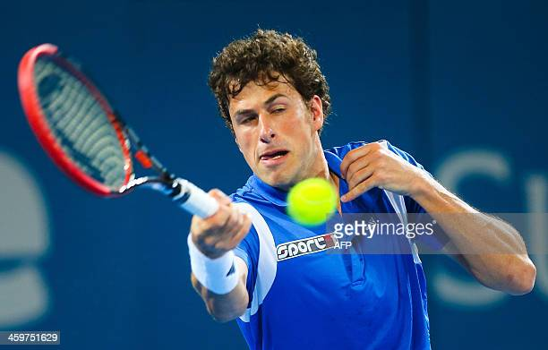 Robin Hasse of the Netherlands returns a serve during his first round match against Grigor Dimitrov of Bulgaria at the Brisbane International tennis...
