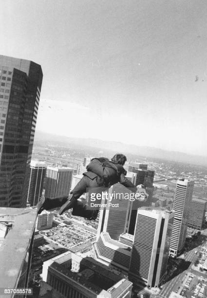 Robin Heid leaps from the top of the 1999 Building in Denver as a publicity stunt for his new book. Credit: The Denver Post