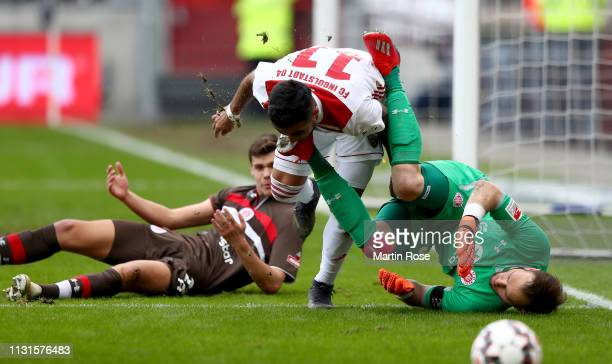 Robin Himmelmann goalkeeper of St Pauli makes a save against Dario Lezcano of Ingolstadt during the Second Bundesliga match between FC St Pauli and...