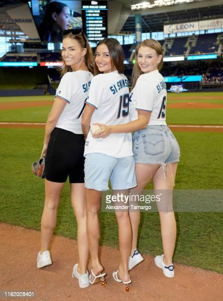 Robin Holzken Kelsey Merritt and Olivia Brower pose before Sports Illustrated Swimsuit Model Search Winner Brooks Nader Throws First Pitch At The...
