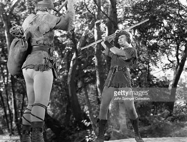 Robin Hood attempts to cross a footbridge held by Little John at their first meeting