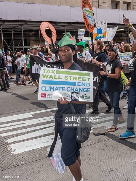 Robin Hood character promotes tax on Wall Street to end climate change