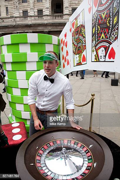 Robin Hood Tax supporters protest near the Bank of England in the City of London Campaigners today set up a giant roulette table in the City of...
