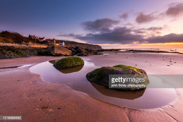 robin hoods bay beach, north york moors national park. - north yorkshire stock pictures, royalty-free photos & images