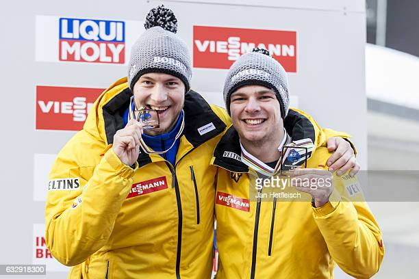 Robin Johannes Geueke and David Gamm of Germany pose for a picture at the victory ceremony of the Men's Double competition during the second day of...