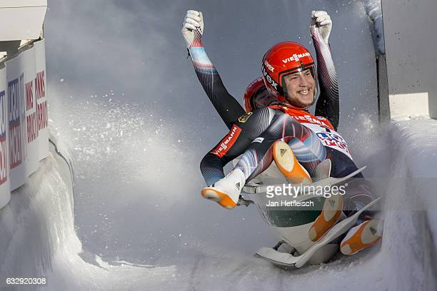 Robin Johannes Geueke and David Gamm of Germany react after their second run of the Men's Double Luge competition during the second day of the...