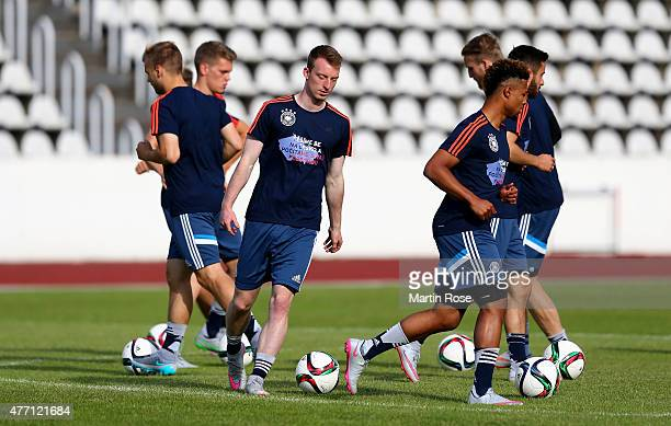 Robin Knoche of Germany runs with the ball during a training session ahead of the EURO 2015 Group A match against Serbia at Strahov stadium on June...