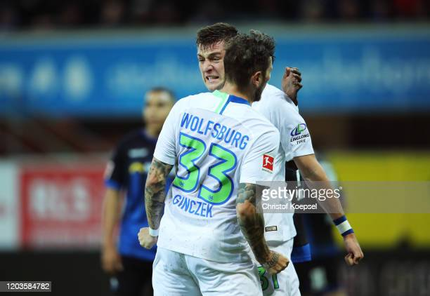 Robin Knoche of VfL Wolfsburg celebrates scoring his sides first goal with Daniel Ginczek of VfL Wolfsburg during the Bundesliga match between SC...
